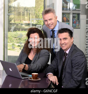 Portrait happy business people behind laptop look at camera in a large cooperate modern office, coffee and strategy planning