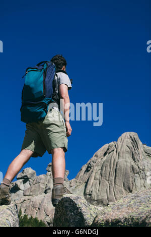 Spain, hiker with a backpack in Regional Park La Pedriza - Stock Photo