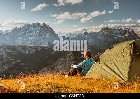sportsman in high mountains camping - Stock Photo