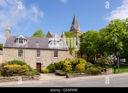 Stone cottage by 13th century Dornoch Cathedral in historic Royal Burgh of Dornoch, Sutherland, Highland Region, - Stock Photo