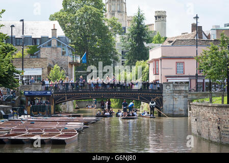 Punts, tourists and the river Cam at Quayside with the bridge at Bridge Street Cambridge UK in summer - Stock Photo