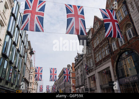 London, UK - June 16, 2016 : Union Jack Flag bunting in New Bond Street, London, to mark the 90th birthday of Queen - Stock Photo
