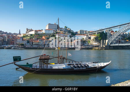 A traditional Rabelo boat, used for transportation of port wine, Porto, Portugal - Stock Photo