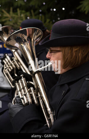 UK, Gloucestershire, Gloucester, Eastgate Street, Salvation Army band playing outside at Christmas, female horn - Stock Photo