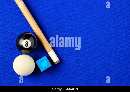 Billiard balls, cue and chalk on a blue pool table. Viewed from above. Horizontal image. - Stock Photo