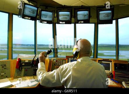 An air traffic controller at Glasgow Airport - Stock Photo