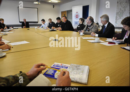 Prime Minister David Cameron (5th right) meets multi agency representatives at Silver Command in Gloucester to discuss - Stock Photo
