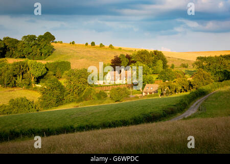 Evening sunlight over Cotswolds cottages near Snowshill, Gloucestershire, England - Stock Photo