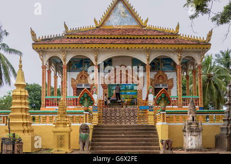 A Buddhist shrine at Kampong Phluk gets a new coat of paint, Cambodia - Stock Photo