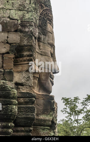 Compassionate buddha (Lokesvara), Bayon Temple, Angkor Thom, near Siem Reap, Cambodia - Stock Photo