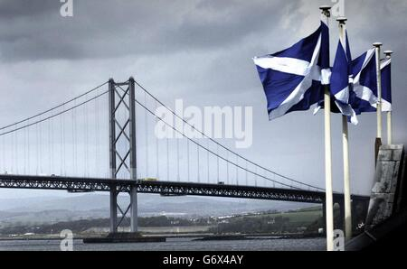 Scottish flags fly in front of the Forth Road Bridge