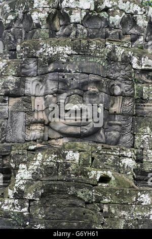 Smiling face of Lokesvara (compassionate Buddha), Prasat Bayon, Angkor Thom, Cambodia - Stock Photo