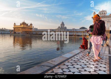 Unidentified young Sikh men visiting Golden Temple (Harmandir Sahib also arbar Sahib) - Stock Photo