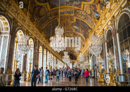 Visitors in the Hall of Mirrors, Palace of Versailles, Yvelines, Region Ile-de-France, France - Stock Photo