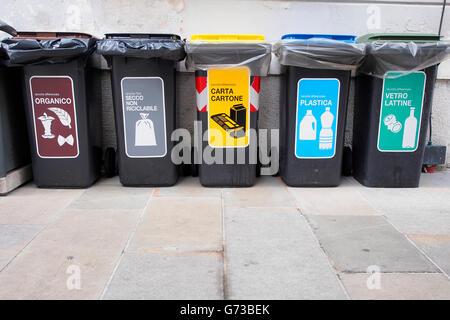 Recycling bins in an Italian street. - Stock Photo