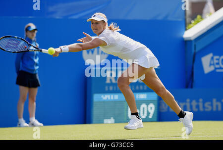 Editorial Use Only - Ekaterina Makarova of Russia plays a forehand shot against Britain's Tara Moore in their first - Stock Photo