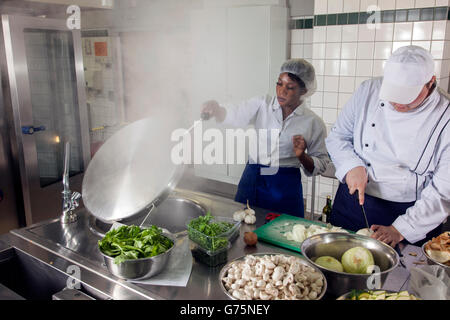 Preparations for lunch in a commercial kitchen. - Stock Photo