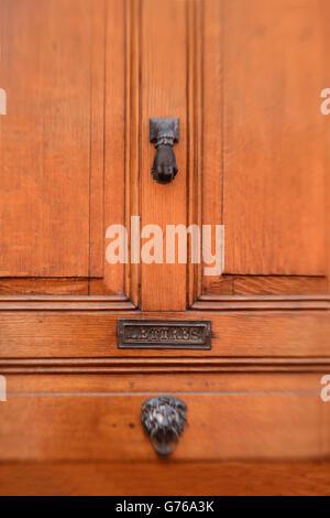 ... Dark wooden door with hand as door knocker also showing mail slot in door. & Mail slot in door Stock Photo Royalty Free Image: 17103918 - Alamy pezcame.com