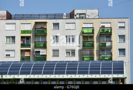 Apartment building and solar panels on the roof - Stock Photo