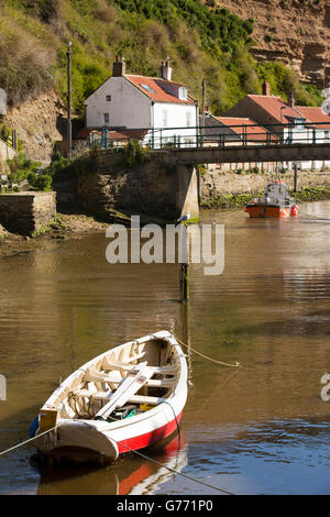 UK, England, Yorkshire, Staithes, boat on Staithes Beck at the footbridge - Stock Photo