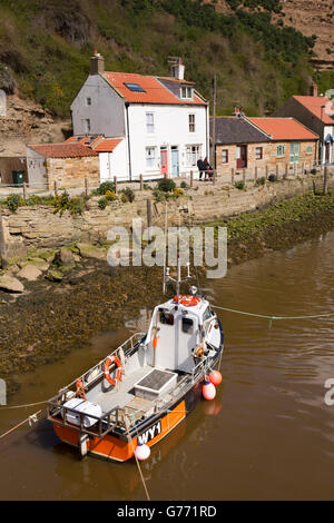 UK, England, Yorkshire, Staithes, boat on Staithes Beck at Cowbar Lane - Stock Photo
