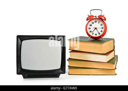 Vintage analog portable TV, some old books and retro alarm clock  isolated on white - Stock Photo