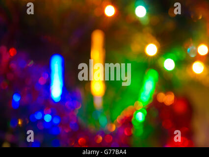 Multicolor bokeh moving blur background (Christmas lights) - Stock Photo