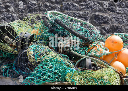 nets and flotation devices for fishing boats on the harbor - Stock Photo
