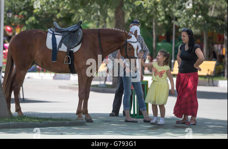 Rostov-on-Don, Russia- June 19: Girl with relatives thanks for horse riding - Stock Photo