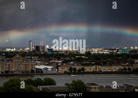 London, UK. 25th June, 2016. UK Weather: Colourful rainbow breaks after a brief rainstorm over south east London - Stock Photo