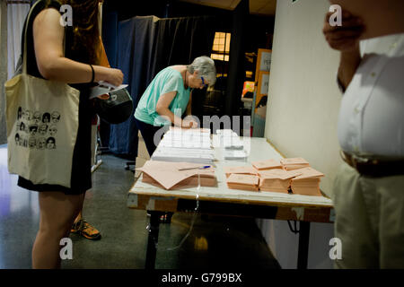 Barcelona, Spain. 26th June, 2016. A woman looks at ballots in a polling station in Barcelona, Spain. Spaniards - Stock Photo