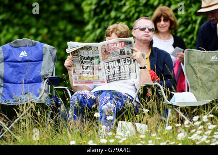 Arundel West Sussex UK 26th June 2016 - A woman reads the Sun on Sunday newspaper at Arundel in warm sunny weather - Stock Photo