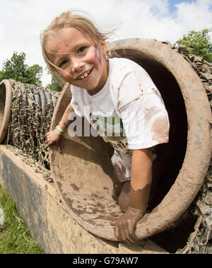 Girl on mini Tough Mudder course at Drumlanrig Castle, Dumfries and Galloway, Scotland, UK. - Stock Photo