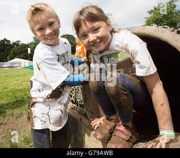 Mini Mudders on the junior obstacle course. Drumlanrig Castle, Dumfries and Galloway, Scotland, UK. 26th June, 2016. - Stock Photo