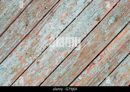 Fragment of the surface of the old wooden planks on a diagonal frame with natural texture and a shabby green paint - Stock Photo