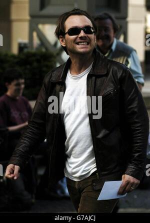 Christian Slater outside the Sheraton hotel - Stock Photo