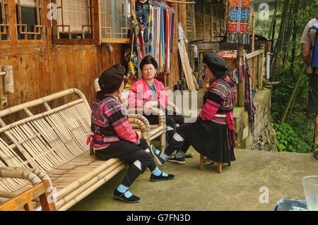 Yao women chatting, Dazhai village, Guangxi Autonomous Region, China - Stock Photo