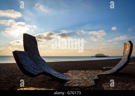 Abstract sculpture by Charles Hadcock on Brighton beach in England, UK. West Pier in the background. November 2010.