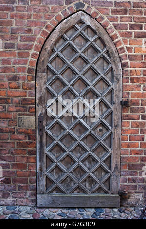 Old Wooden Door In Red Brick Wall Gothic To St Marys Church Gdansk Poland