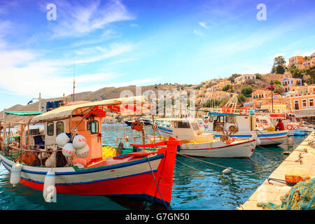 Fishing boats in picturesque harbor on the island of Symi in Agean Sea. - Stock Photo