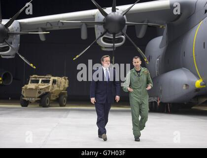 Prime Minister David Cameron views a newly delivered A400M Atlas aircraft with wing commander Simon Boyle (right) at RAF Brize Norton, England.