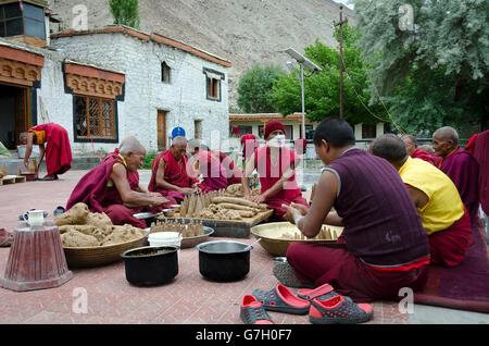 Monks preparing for a festival, Samstanling Gompa, Sumur, Nubra Valley, near Leh, Ladakh, Jammu and Kashmir, India - Stock Photo