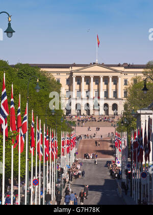 Karl Johan the parade street in Norwegian capital Oslo, flags leading up to the  royal palace, Constitution day - Stock Photo