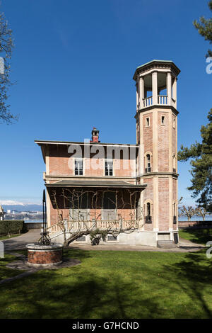A small side house with a tower and a fountain at the gates of  the Park La Grange in Geneva, Switzerland - Stock Photo