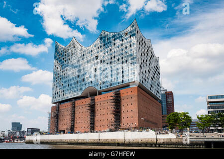 View of new Elbphilharmonie concert hall nearing completion on River Elbe in Hamburg Germany - Stock Photo