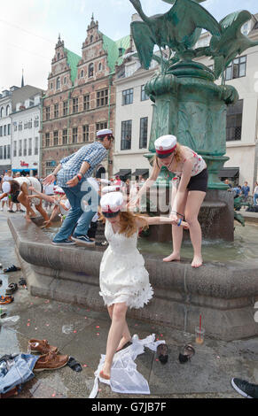 Danish students celebrate their high school graduation with the traditional dip in the Stork Fountain, Storkespringvandet, - Stock Photo