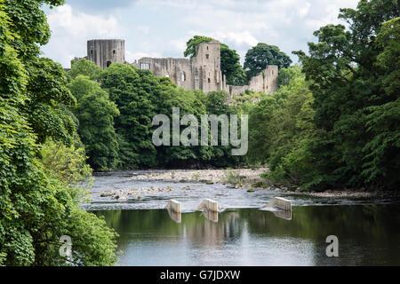 The 12th century castle built by Bernard de Balliol reflected in the River Tees, Barnard Castle, County Durham, - Stock Photo