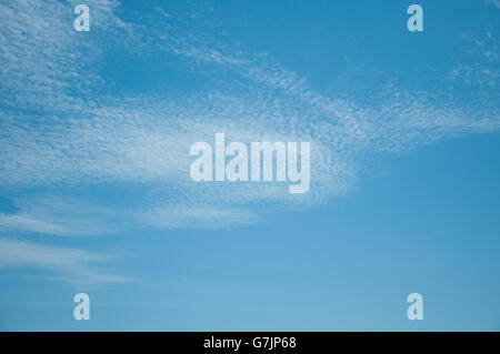 fantastic and very white clouds in a beautiful blue sky - Stock Photo