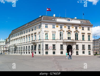 Ballhaus square with people and Federal Chancellery or BKA, Bundeskanzleramt govenment building in inner city of - Stock Photo