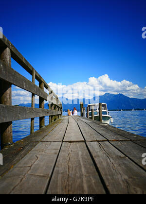 Europe Germany Chiemgau Chiemsee lake Prien wooden bridge boat mooring - Stock Photo